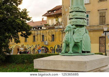 LJUBLJANA SLOVENIA - JULY 9 2009: A small decorative dragon sculpture at the base of a lamp post on the Dragon Bridge