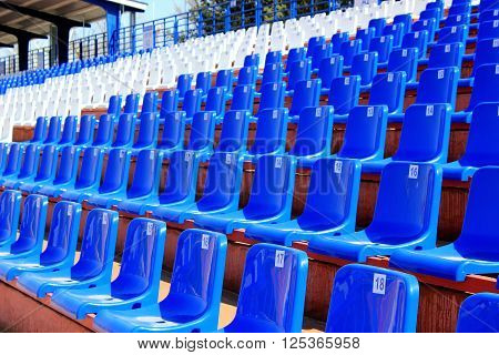 Tribune with chairs at small old stadium