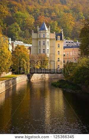 beautiful autumn landscape of river and castle in Carlovy Vary, Czech Republic