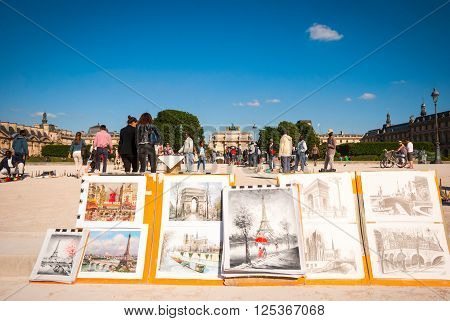 PARIS FRANCE - JUNE 8: Art images featuring parisian main attractions for sale in Jardin des Tuileries next to Louvre palace on June 8 2015