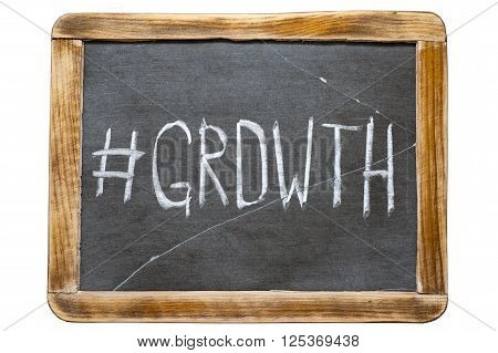 growth hashtag handwritten on vintage school slate board isolated on white