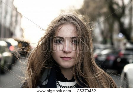 Young Smiling Woman Walking On The Street