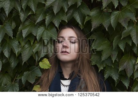 Young Woman On A Green Wall Background
