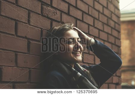 Happy Young Woman Is Laughing