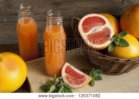 Natural And Fresh Grapefruit Juice In Small Bottles