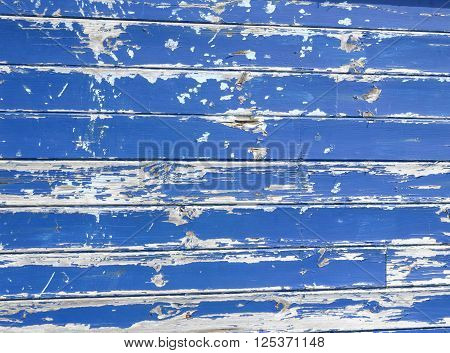 Wood grungy texture with flaked blue paint
