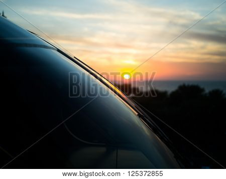 Beautfiuful sunset in Dubai with the sun reflectinf of the mirror of metro train ** Note: Visible grain at 100%, best at smaller sizes