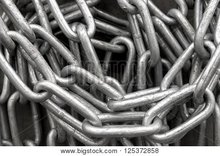 Close up of heap of shiny metal chain