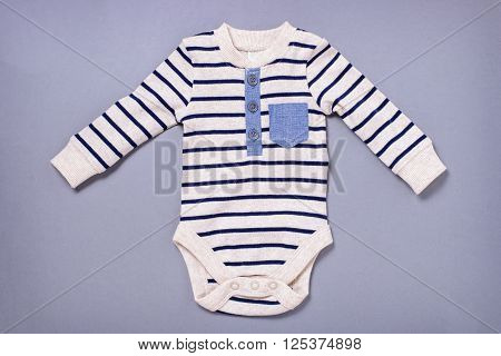 Cute Baby Jumpsuit On Blue Background