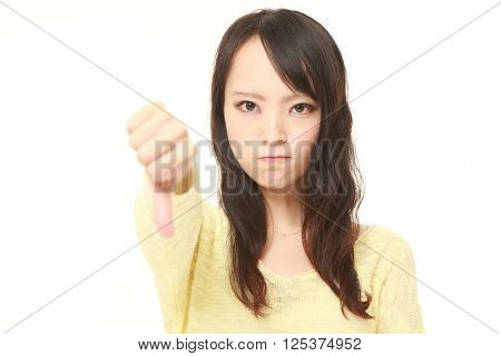 young Japanese woman with thumbs down gesture ** Note: Visible grain at 100%, best at smaller sizes