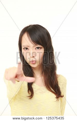 young Japanese woman scolding on white background
