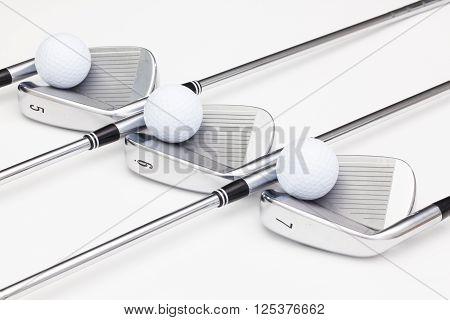 Titanium golf clubs on the white background