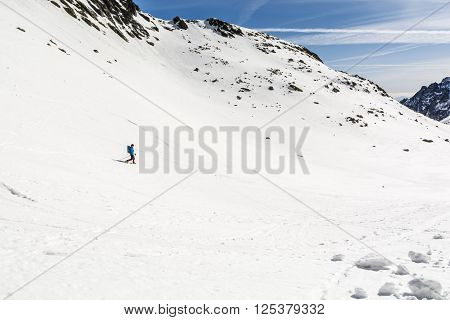 Mountaineer Descends A Snowy Slope.