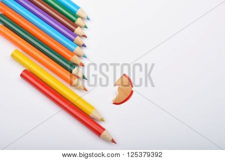 Close Up Of Arranged Colored Pencils With Pencil Shavings On White Background. Selective Focus