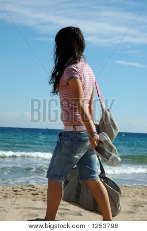 Girl Walks To The Beach