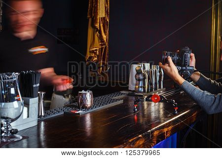 GRODNO BELARUS - NOV 7 2015: A film crew shoots a movie about work of bartender in gastrobar HOUDINI. Grodno Belarus November 7 2015