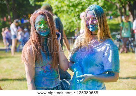 Vitebsk, Belarus - July 4, 2015: Happy people at the Holi color festival