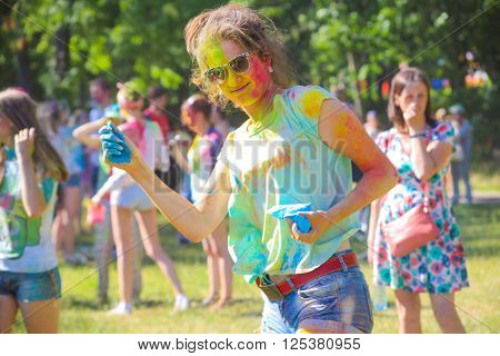Vitebsk, Belarus - July 4, 2015: Happy woman face close-up at the Holi color festival