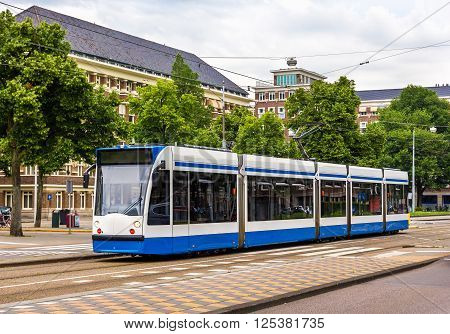 A tram driving in Amsterdam - the Netherlands ** Note: Visible grain at 100%, best at smaller sizes