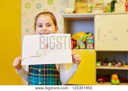 A little girl showing you the picture she'd drawn