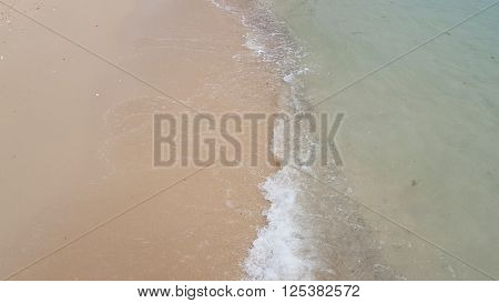 Clear seawater and sand beach in tropical island
