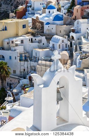 A view of a church bell tower from Oia on the greek isle of Santorini. Focus on the bell tower giving the background a shallow DOF.