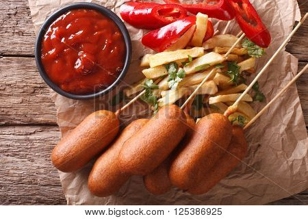 Corn Dogs, French Fries, Pepper And Ketchup Close-up. Horizontal Top View