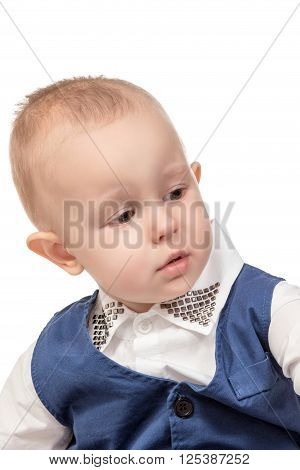 Portrait of a little boy in a blue suit closeup looking sideways isolated on white background