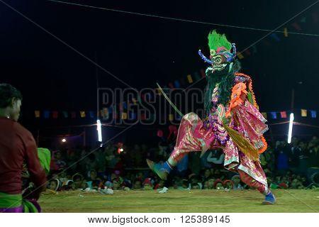 BAMNIA PURULIA WEST BENGAL INDIA - DECEMBER 23RD 2015 : Dancer performing at Chhau Dance festival resurrecting a demon. It is a Indian tribal martial dance based on Hindu myth.
