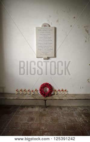 ST GEORGE'S CHURCH IVYCHURCH KENT UK 25 FEBRUARY 2016 - War memorial for the great war of 1914 - 1918 and poppy tributes