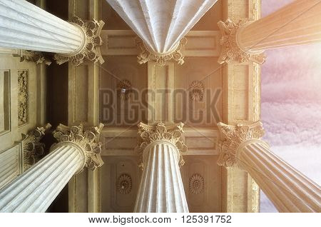 Closeup view of colonnade tops and the ceiling of famous Kazan Cathedral under soft sunlight in Saint-Petersburg Russia.