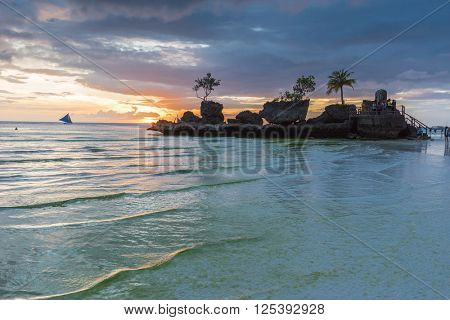 Tropical background sunset view from Boracay island at White Beach with traditional Philippines boats. Travel Vacation at Philippines,