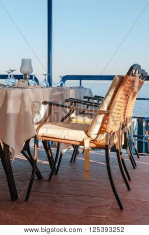 Cushioned Dining Chairs In A Luxury Restaurant Overlooking The Tropical Sea