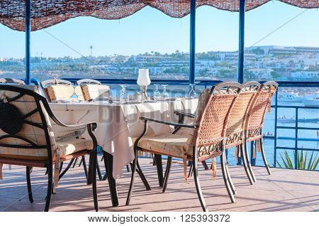 Restaurant Dining Tables Overlooking A Bay At A Tropical Tourist Destination