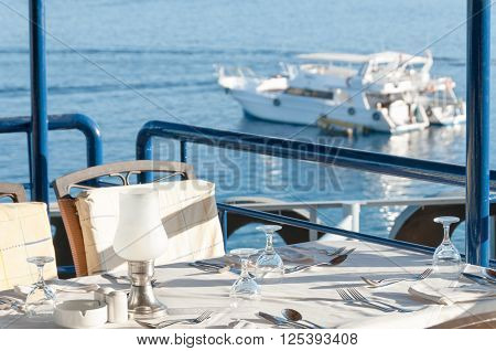 Restaurant Dining Table With A View Of Yachts In The Bay