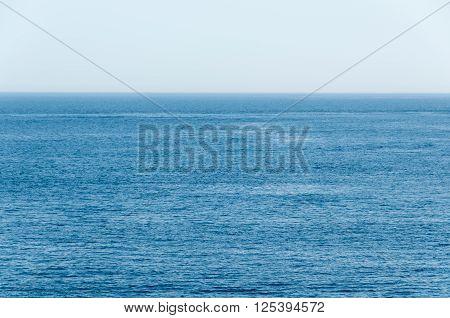 Deep Blue, Tropical Ocean Stretches To The Horizon