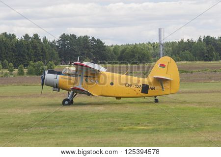 Minsk Belarus-June 21 2014: Airplane AN-2 on Takeoff and Landing Strip In Front of Spectators During Aviation Sport Event Dedicated to the 80th Anniversary of DOSAAF Foundation in Minsk on June 21 2014 Minsk Republic of Belarus