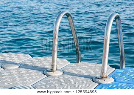 Boarding Ladder For Swimmers Mounted On A Plastic Floating Dock