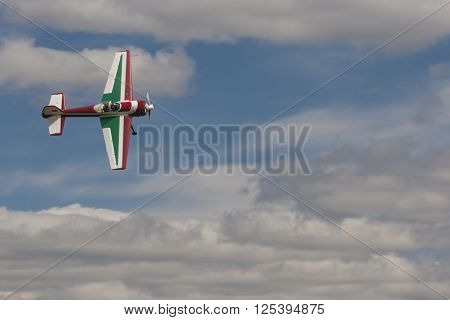 Minsk Belarus-June 21 2014: SU-26M Acrobatics Stunt Plane Performing Elements in Air During Aviation Sport Event Dedicated to the 80th Anniversary of DOSAAF Foundation in Minsk on June 21 2014 in Minsk Republic of Belarus