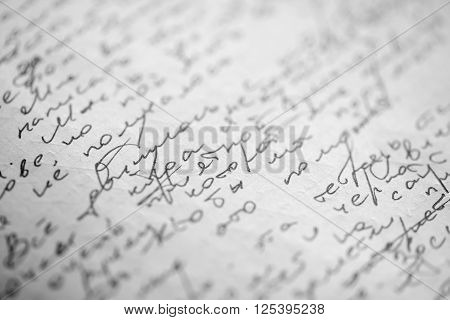 Hastily scrawled handwriting of cyrillic text using black ink on white paper with visible imprints from writing on the obverse.
