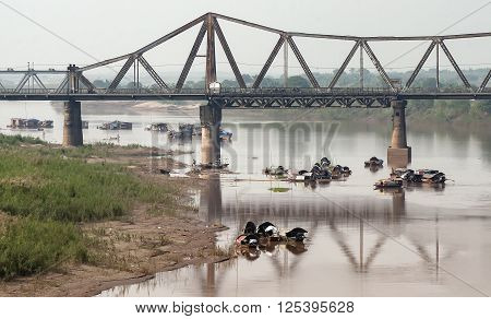 HA NOI, VIET NAM, January 23, 2016 Long Bien Bridge, spanning the Red River in Ha Noi, Vietnam, by the French architect construction