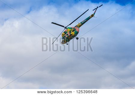 Minsk Belarus-June 21 2014: MI-2 Helicopter on Air During Aviation Sport Event Dedicated to the 80th Anniversary of DOSAAF Foundation in Minsk on June 21 2014 in Minsk Republic of Belarus