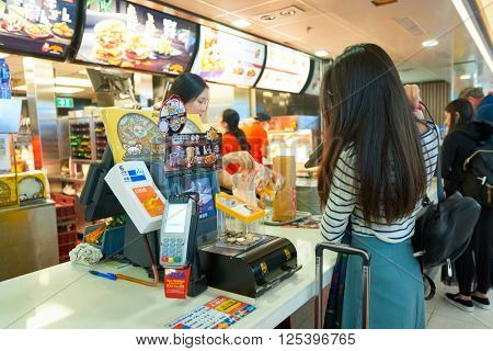 HONG KONG - MARCH 08, 2016: McDonald's restaurant in the Airport. McDonald's primarily sells hamburgers, cheeseburgers, chicken, french fries, breakfast items, soft drinks, milkshakes, and desserts