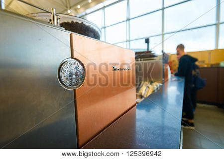 HONG KONG -  MARCH 08, 2016: Starbucks cafe at Hong Kong Airport. Starbucks Corporation is an American global coffee company and coffeehouse chain based in Seattle, Washington