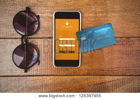 Digitally generated image of world credit card against view of glasses and a smartphone