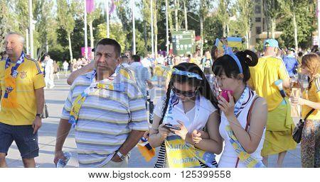 DONETSK UKRAINE - JUNE 19 2012: Unidentified Ukrainian soccer fans before UEFA EURO 2012 match in Donetsk on Donbass Arena