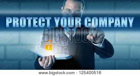 Security advisor is touching PROTECT YOUR COMPANY on a virtual touch screen interface. Business challenge concept and information technology metaphor. Call to action for corporate security measures.