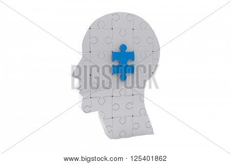 Brain with jigsaw piece against white background with vignette
