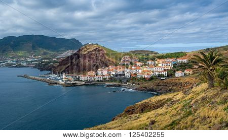 Panoramic view of Canical small town, lighthouse and yacht marina. East coast of Madeira island, Portugal.