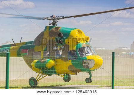 Minsk, Belarus-June 21, 2014: MI-2 Helicopter on Air During Aviation Sport Event Dedicated to the 80th Anniversary of DOSAAF Foundation in Minsk on June 21, 2014 in Minsk, Republic of Belarus